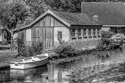 Photograph - Summer Cottage On The River In Black And White by Debra and Dave Vanderlaan