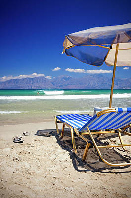 Lounge Chair Photograph - Sun Chairs And Umbrella On Beach by Mbbirdy