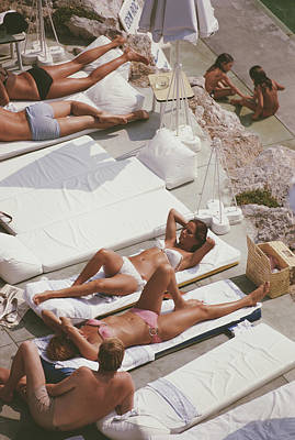Hotel Photograph - Sunbathers At Eden Roc by Slim Aarons