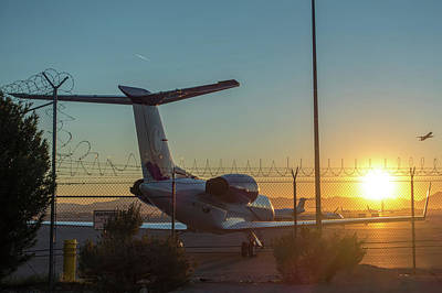 Photograph - Sunrise At The Airport With Barbed Wire Security Fence And Jetli by Alex Grichenko