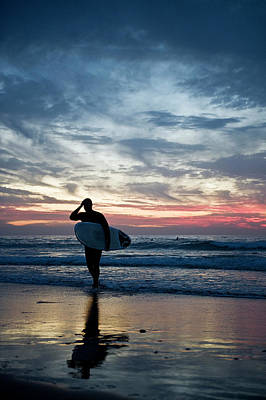 Holding Photograph - Surfer At The Ocean At Sunset by Daniel Reiter / Stock4b