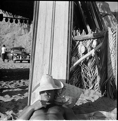 Photograph - Surfer Beach Bum Napping Against His by Loomis Dean
