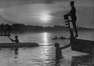 Photograph - Swimmers Silhouetted As They Enjoy Vario by Time Life Pictures