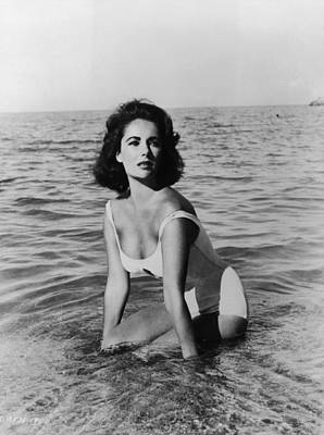 Elizabeth Taylor Wall Art - Photograph - Taylor In Surf by Hulton Archive