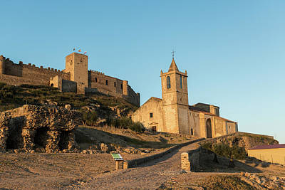 Modern Sophistication Beaches And Waves - The church of Santiago Apostol and the castle of Medellin seen at sunset, Extremadura, Spain. by Esteban Martinena Guerrero