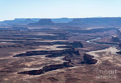 Photograph - The Green River Runs Through A Deep Canyon At Canyonlands Nation by William Kuta
