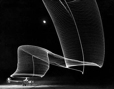 Photograph - The Light Trail Of A Helicopter by Andreas Feininger