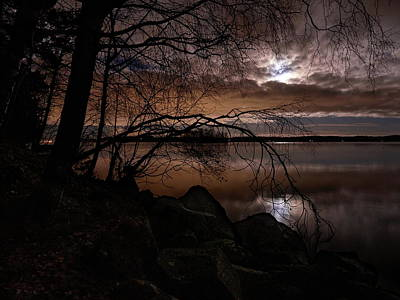 Jouko Lehto Royalty-Free and Rights-Managed Images - The moon the copper clouds and the lake by Jouko Lehto