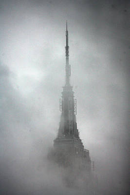 Photograph - The Rains Recede And The Empire State by New York Daily News Archive