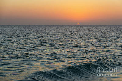 Photograph - The Sunset Turns The Sky Orange And Yellow Along The Beach On An by William Kuta