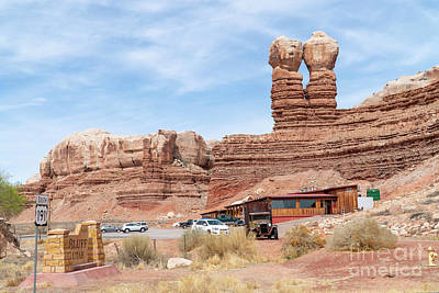Photograph - The Twin Rocks Trading Post Sits Beneath The Twin Rocks Or Navaj by William Kuta