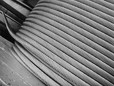 Photograph - Thick Aluminum Cable Being Wound On A Hu by Margaret Bourke-white