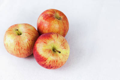 Photograph - Three Apples From Above by Jeanette Fellows
