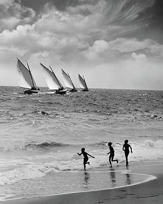 Recreational Boat Photograph - Three Boys Running Along Beach by Stockbyte