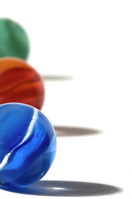 Photograph - Three Different Colored Marbles Aligned by Daryl Solomon