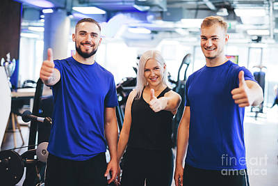 Photograph - Three Happy People At The Gym Showing Thumbs Up. by Michal Bednarek