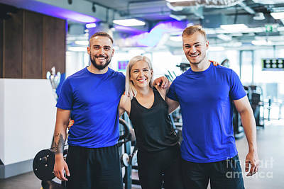 Photograph - Three Happy Young People Standing At The Gym. by Michal Bednarek