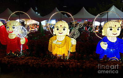 Photograph - Three Lanterns In The Shape Of Buddhist Monks by Yali Shi