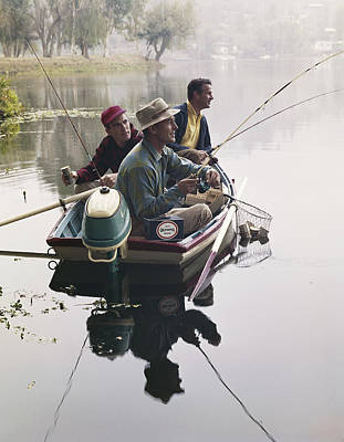 Photograph - Three Men Sitting In Motorboat And by Tom Kelley Archive