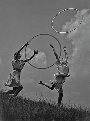 Photograph - Throwing Hula Hoops by Fpg