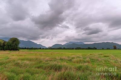Rowing - Thunderclouds above farmland. by Viktor Birkus