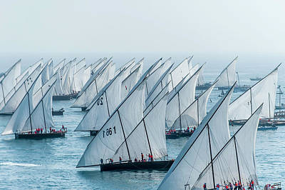 Dhow Photograph - Traditional Sailing Dhows Racing Off by Paul Todd