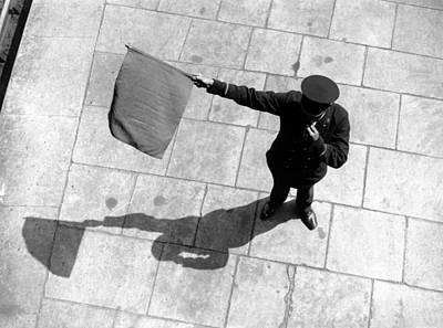 Photograph - Train Station Guard Waving Flag by Hulton Archive