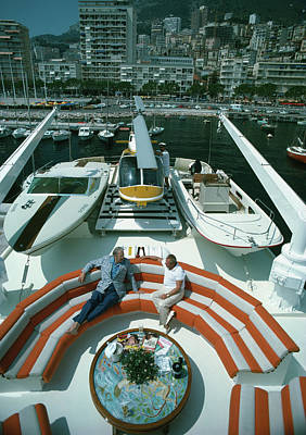 Sitting Photograph - Transport Buffs by Slim Aarons
