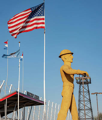 Photograph - Tulsa Golden Driller And Flags by Gregory Ballos