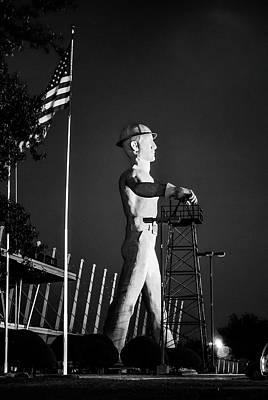 Photograph - Tulsa Golden Driller And Usa Flag - Monochrome by Gregory Ballos