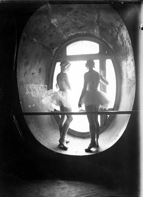 Photograph - Two Ballerinas Standing In Window Of by Alfred Eisenstaedt