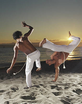 Balance Photograph - Two Capoeira Performers On Beach At by Ryan Mcvay