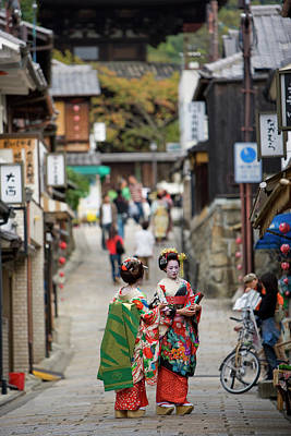Photograph - Two Geisha Standing In An Alleyway by Alexanderclayton
