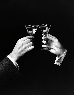 Photograph - Two Hands Toasting With Martini Against by Superstock