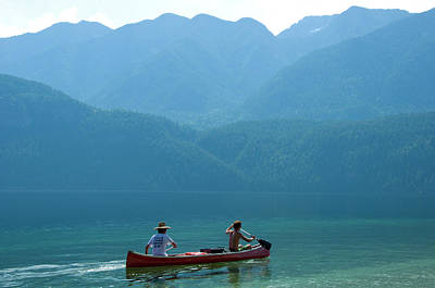 Oar Photograph - Two Men Paddling A Canoe During Summer by Steve Ogle