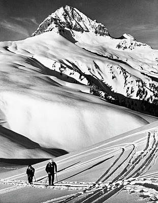 Photograph - Two People Skiing On A Snow Covered by Superstock