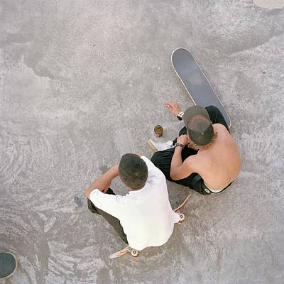 Bottle Cap Photograph - Two Teenagers Sat In Skate Park, Aerial by Uta Neumann