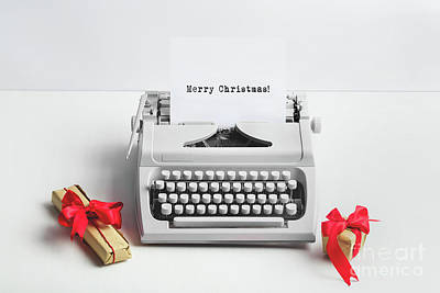 Photograph - Typewriter With Merry Christmas Text And Gifts by Michal Bednarek