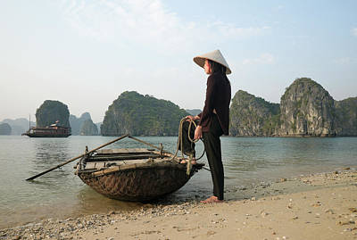Photograph - Vietnam,halong Bay,woman With Boat by Martin Puddy