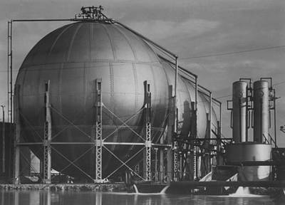 Texaco Wall Art - Photograph - View Of Storage Tanks At A Texaco Oil Re by Margaret Bourke-white