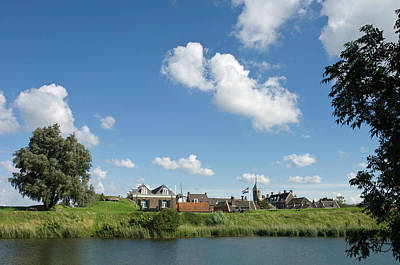Trapped Photograph - Village Behind The Dikes by Digiclicks