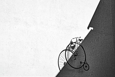 Photograph - Vintage Bicycle On A Wall by Stuart Litoff