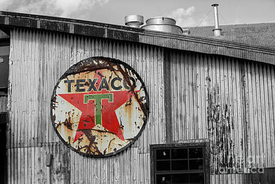 Uncle Sam Posters Rights Managed Images - Vintage texaco sign on old building Royalty-Free Image by Patricia Hofmeester