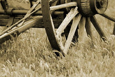 Photograph - Vintage Wagon Wheel In Sepia by Colleen Cornelius