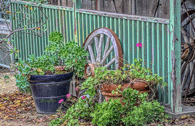 Photograph - Wagon Wheels And Potted Plants by Barbara Snyder