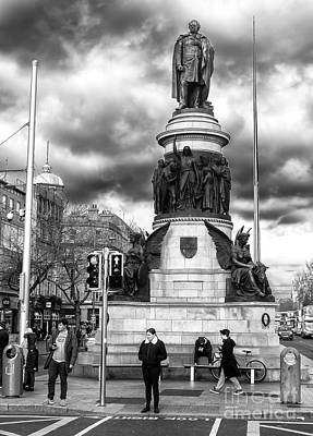Photograph - Waiting On O'connell Street Dublin by John Rizzuto