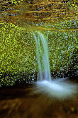 Photograph - Water Flowing Over Rock In River by Adstock/universal Images Group