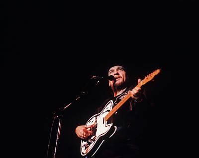 Photograph - Waylon Jennings Performs On Stage by David Redfern