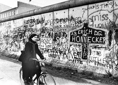 Photograph - West Berlin Woman Rides Bicycle Past by New York Daily News Archive