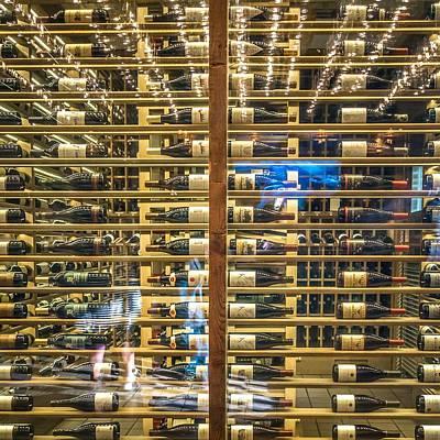 Photograph - Wine Bottles On Wine Racks In A Restaurant by Alex Grichenko